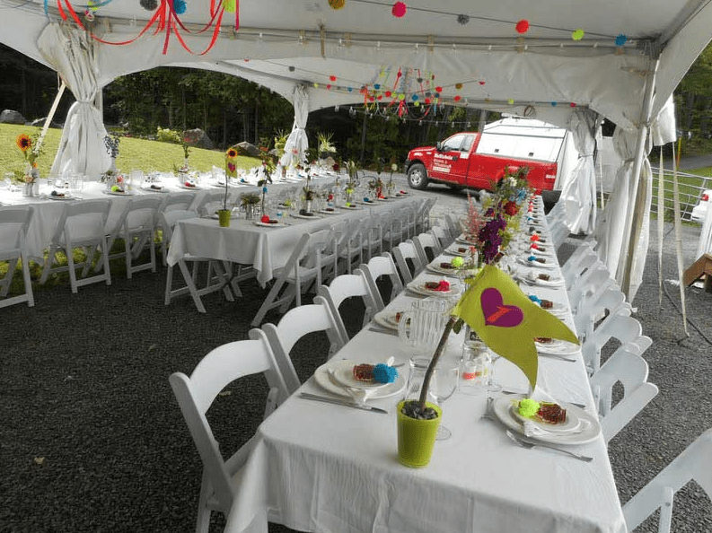 white tent with birthday cake on tables