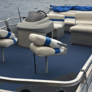 pontoon boat tied to dock