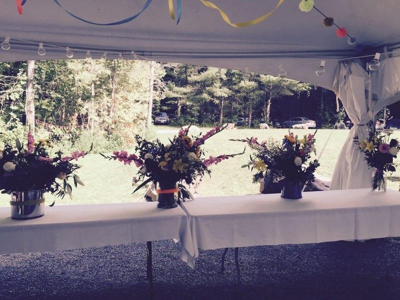 wedding flowers in tent